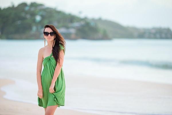 Young beautiful Ukrainian woman having fun posing for the camera on a tropical seashore